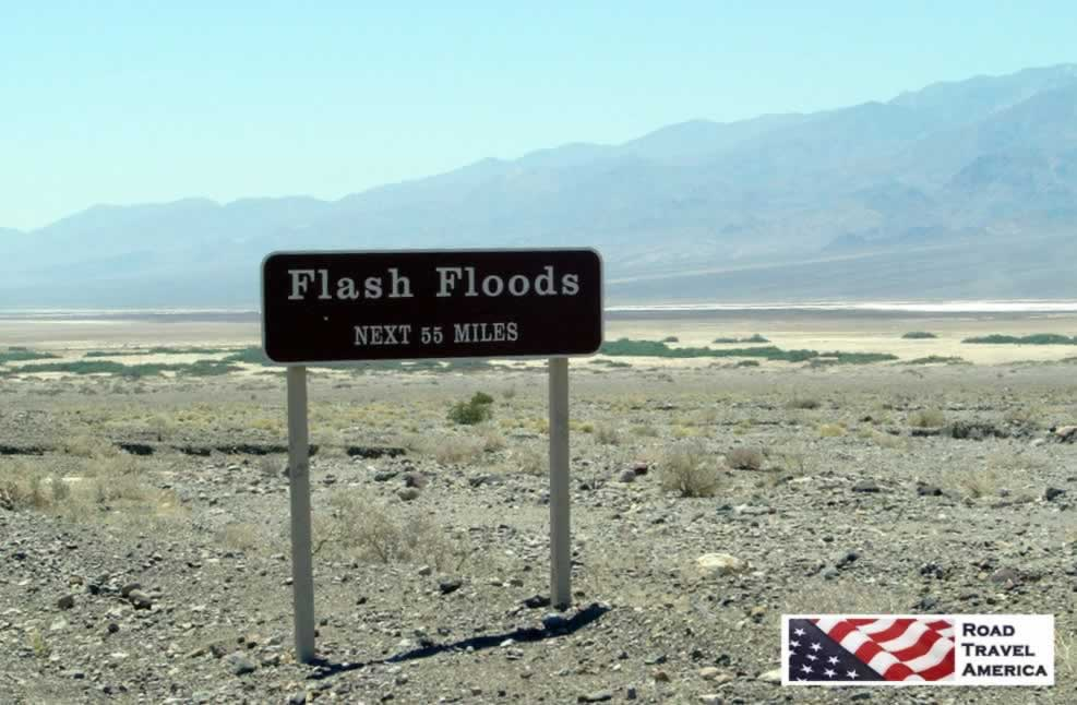 Sign warning of flash floods in Death Valley National Park, next 55 miles