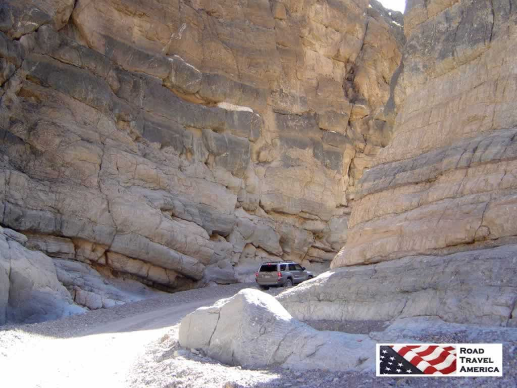 The narrow passage between towering rocks in Titus Canyon Road in Death Valley National Park