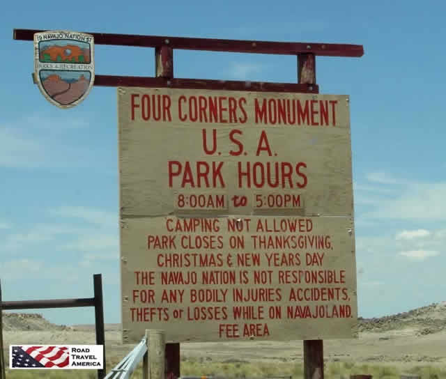 Four Corners Monument U.S.A. sign showing opening hours and restrictions