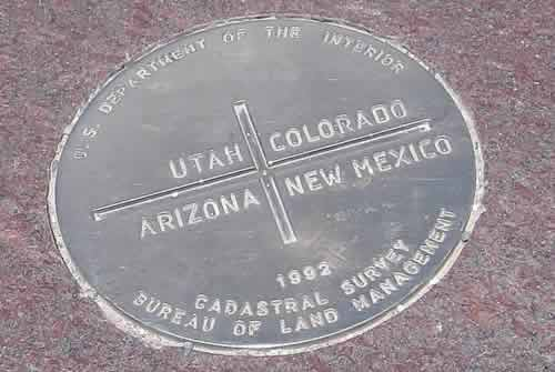 Four Corners Monument survey plaque marking the meeting point of Utah, Colorado, Arizona and New Mexico