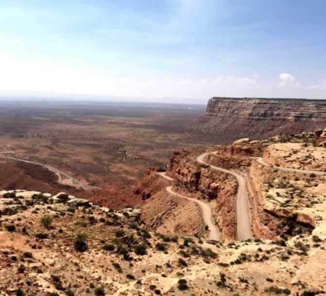 Aerial view of the Moki Dugway in Utah, seen from the top of Cedar Mesa, with the Valley of the Gods below